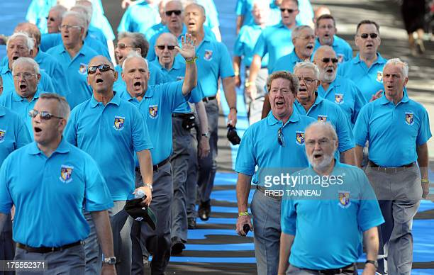 Wales male choir Cor Meibion Cwmbach performs on August 4 2013 in the streets of Lorient western France during the Grande Parade at the Interceltic...