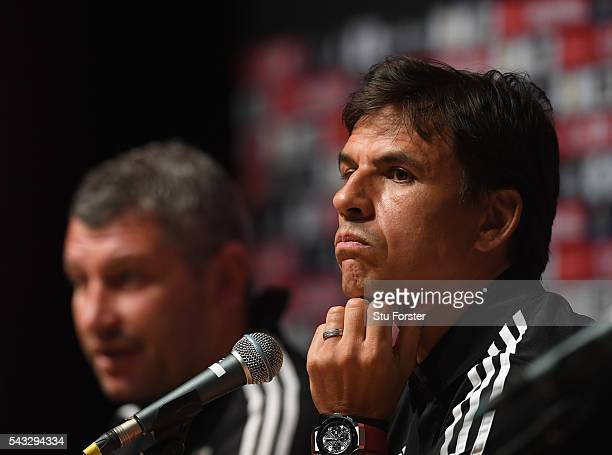 Wales manager Chris Coleman and assistant Osian Roberts face the media during a Wales press conference at their Dinard base camp ahead of their Euro...