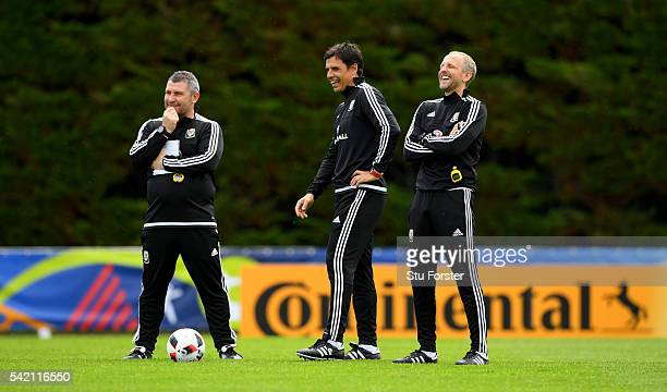 Wales manager Chris Coleman and coaches Osian Roberts and Paul Trollope share a joke during Wales training at their Euro 2016 base camp on June 22...