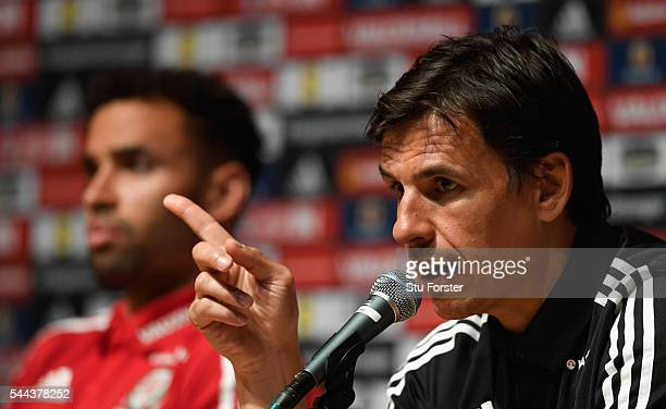 Wales manager Chris Coleman and Hal RobsonKanu face the media at the Wales press conference ahead of their Euro 2016 semi final against Portugal at...