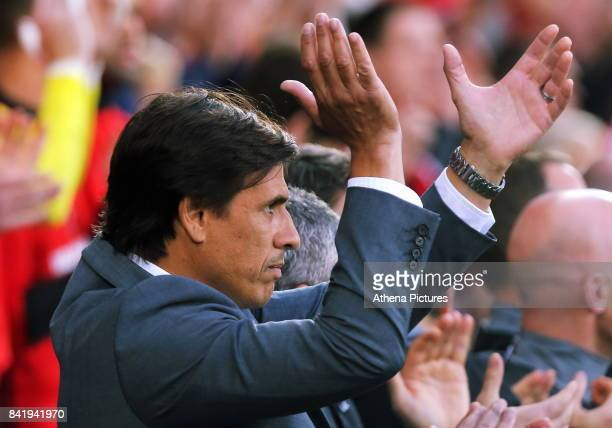 Wales manager Chris Coleman applauds after the national anthem during the FIFA World Cup Qualifier Group D match between Wales and Austria at The...