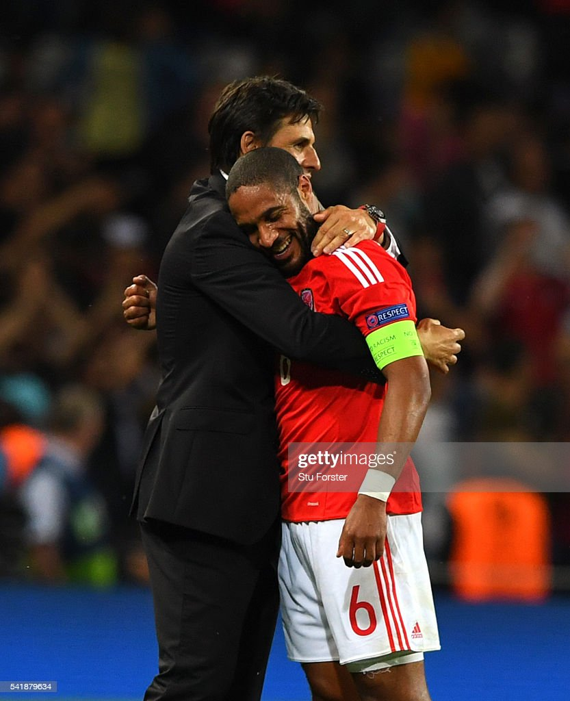 Wales manager Chris Coleman (l) congratulates captain Ashley Williams after the UEFA EURO 2016 Group B match between Russia and Wales at Stadium Municipal on June 20, 2016 in Toulouse, France.