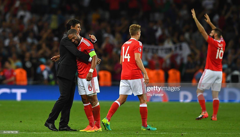 Wales manager Chris Coleman (l) congratulates player Ashley Williams after the UEFA EURO 2016 Group B match between Russia and Wales at Stadium Municipal on June 20, 2016 in Toulouse, France.