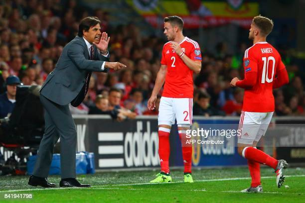 Wales' manager Chris Coleman gestures to Wales' midfielder Aaron Ramsey during the FIFA World Cup 2018 qualification international football match...