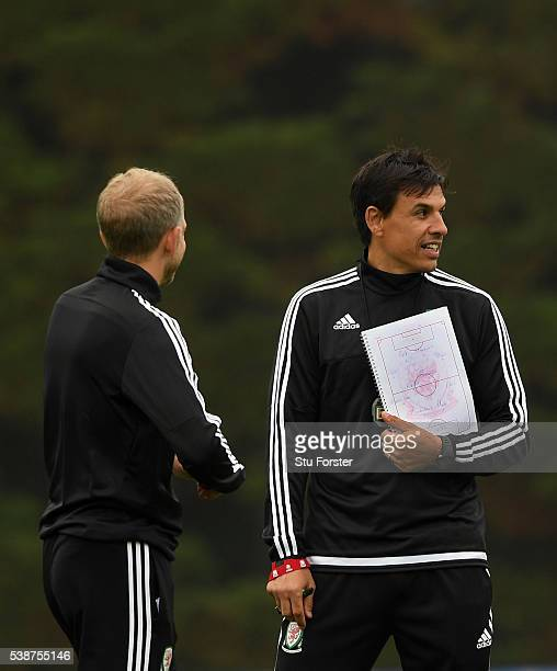 Wales manager Chris Coleman looks on with his notes containing a 'World Team' before an open Euro 2016 Wales training session at the Wales training...