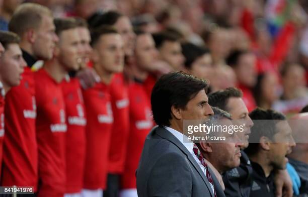 Wales manager Chris Coleman sings the national anthem during the FIFA World Cup Qualifier Group D match between Wales and Austria at The Cardiff City...