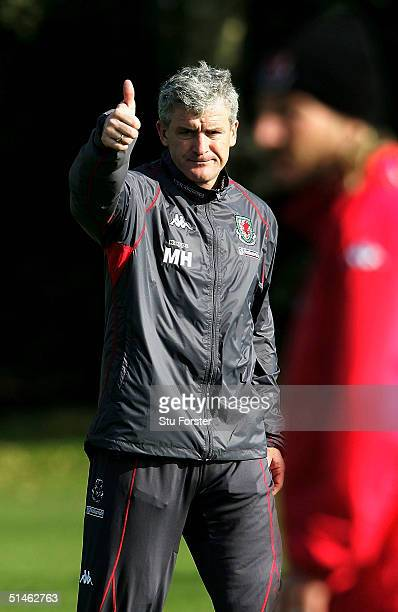 Wales manager Mark Hughes gives a thumbs up during Wales Football training ahead of Wednesday's World Cup Qualifier against Poland at the University...