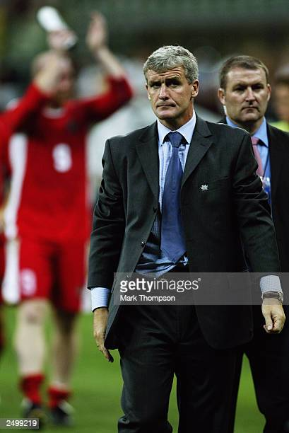 Wales manager Mark Hughes leaves the field looking dejected during the Euro 2004 Qualifying Group 9 match between Italy and Wales on September 6 2003...