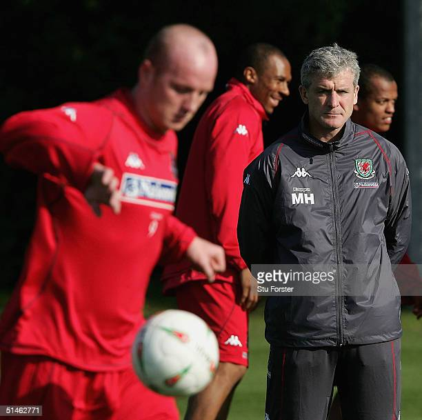 Wales manager Mark Hughes looks on during Wales training ahead of wednesday's game against Poland at the University of Glamorgan Playing Fields...