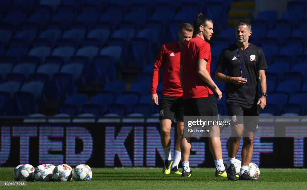 Wales manager Ryan Giggs and Gareth Bale (c) look on during Wales training ahead of their UEFA Group B4 match against Republic of Ireland at Cardiff City Stadium on September 5, 2018 in Cardiff, Wales.