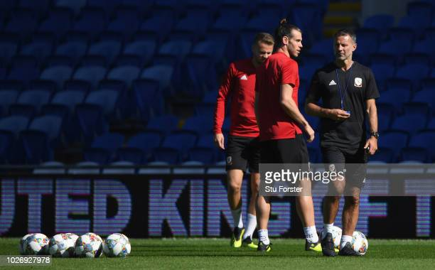 Wales manager Ryan Giggs and Gareth Bale look on during Wales training ahead of their UEFA Group B4 match against Republic of Ireland at Cardiff City...
