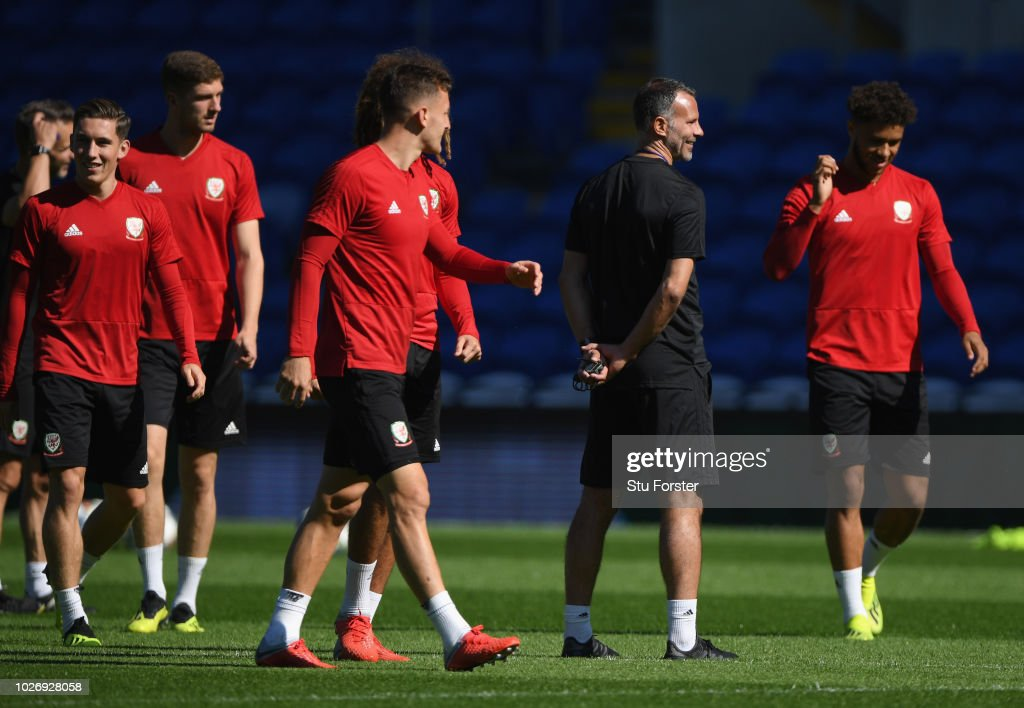 Wales manager Ryan Giggs shares a joke with his players during Wales training ahead of their UEFA Group B4 match against Republic of Ireland at Cardiff City Stadium on September 5, 2018 in Cardiff, Wales.