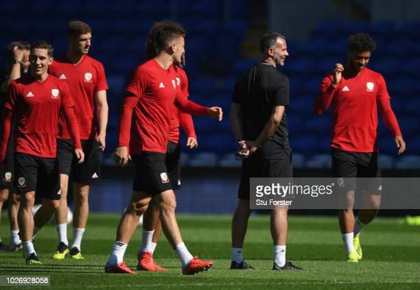 Wales manager Ryan Giggs shares a joke with his players during Wales training ahead of their UEFA Group B4 match against Republic of Ireland at...