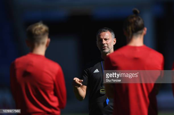 Wales manager Ryan Giggs talks with his players including Gareth Bale during Wales training ahead of their UEFA Group B4 match against Republic of...