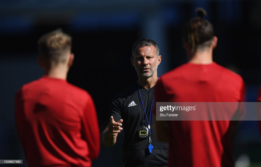Wales manager Ryan Giggs talks with his players including Gareth Bale (r) during Wales training ahead of their UEFA Group B4 match against Republic of Ireland at Cardiff City Stadium on September 5, 2018 in Cardiff, Wales.