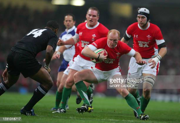 Wales' Martyn Williams sidesteps All Blacks' Joe Rokocoko during their Invesco Challenge rugby union internatonal match Wales vs. New Zealand at the...