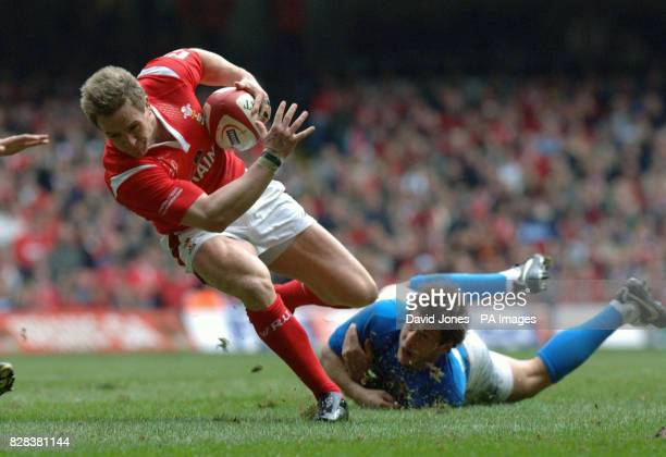 Wales' Matthew Watkins wriggles through the tackle of Italy's Ramiro Pez during the RBS 6 Nations match at the Millennium Stadium Cardiff Saturday...