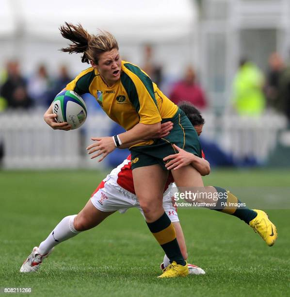 Wales' Melissa Berry tackles Australia's Sharni Williams during the Women's World Cup at Surrey Sports Park Surrey