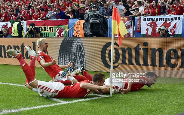 Wales' midfielder Aaron Ramsey and defender Chris Gunter celebrate Wales' forward Hal RobsonKanu goal during the Euro 2016 group B football match...