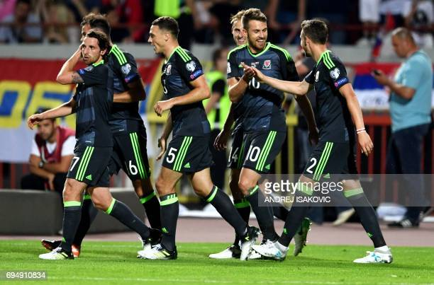 Wales' midfielder Aaron Ramsey and Wales' defender Chris Gunter celebrate after Ramsey converted a penalty during the WC 2018 football qualification...
