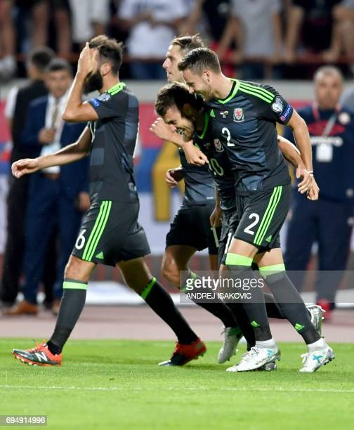 Wales' midfielder Aaron Ramsey and Wales' defender Chris Gunter celebrate after scoring a goal during the FIFA World Cup 2018 qualification football...
