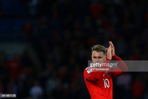 Wales' midfielder Aaron Ramsey applauds the fans at the final whistle of the FIFA World Cup 2018 qualification international football match between...