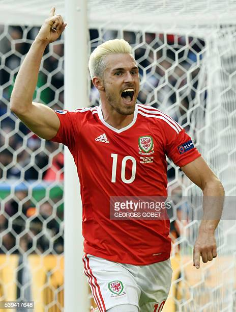 Wales' midfielder Aaron Ramsey celebrates a teammates goal during the Euro 2016 group B football match between Wales and Slovakia at the Stade de...