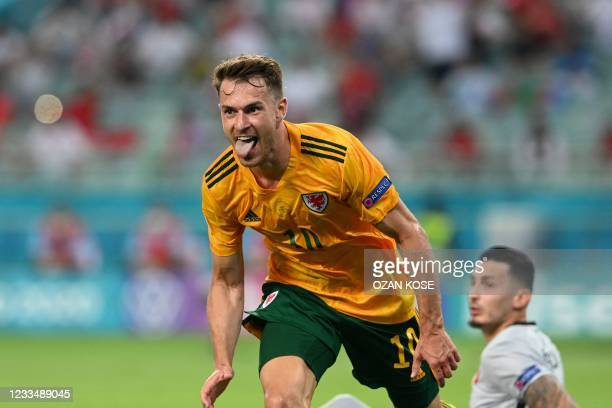 Wales' midfielder Aaron Ramsey celebrates after scoring the opening goal during the UEFA EURO 2020 Group A football match between Turkey and Wales at...