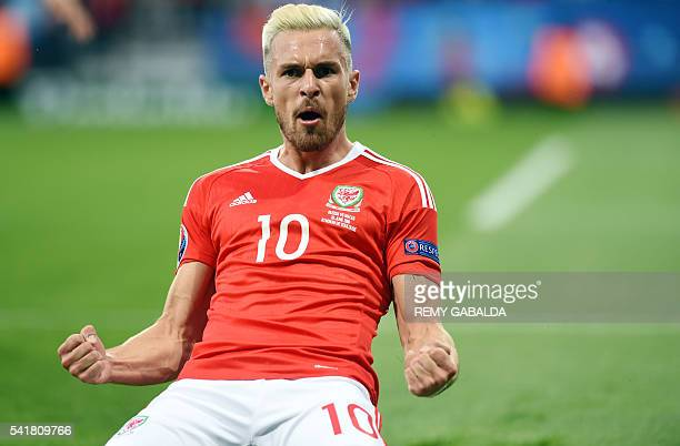 TOPSHOT Wales' midfielder Aaron Ramsey celebrates the team's first goal during the Euro 2016 group B football match between Russia and Wales at the...