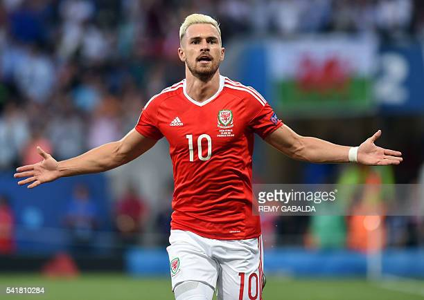 Wales' midfielder Aaron Ramsey celebrates the team's first goal during the Euro 2016 group B football match between Russia and Wales at the Stadium...