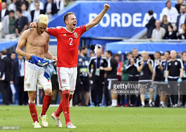 Wales' midfielder Aaron Ramsey celebrates with teammate Wales' defender Chris Gunter following their 21 win over Slovakia in the Euro 2016 group B...