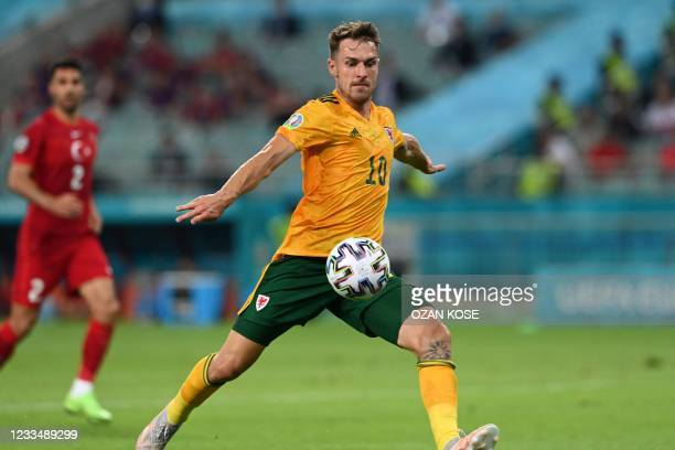 Wales' midfielder Aaron Ramsey prepares to shoot and score the opening goal during the UEFA EURO 2020 Group A football match between Turkey and Wales...