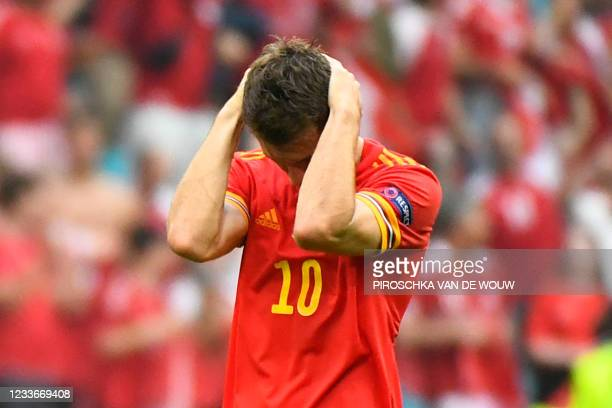 Wales' midfielder Aaron Ramsey reacts after losing during the UEFA EURO 2020 round of 16 football match between Wales and Denmark at the Johan Cruyff...