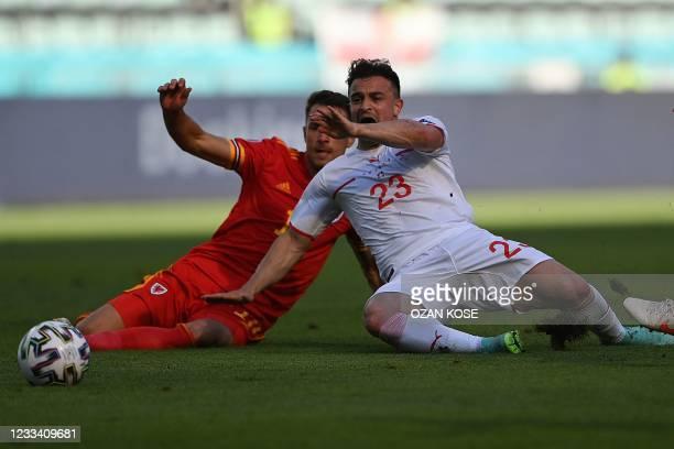 Wales' midfielder Aaron Ramsey tackles the ball away from Switzerland's midfielder Xherdan Shaqiri during the UEFA EURO 2020 Group A football match...