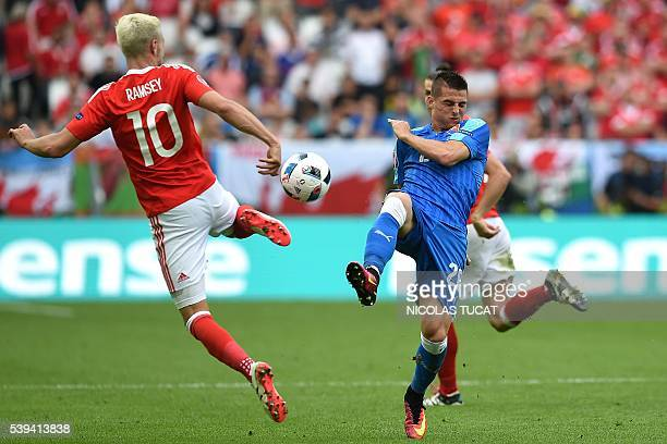 Wales' midfielder Aaron Ramsey vies for the ball with Slovakia's midfielder Robert Mak during the Euro 2016 group B football match between Wales and...