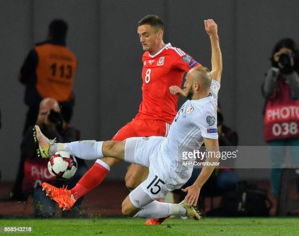 Wales' midfielder Andy King and Georgia's midfielder Valeri Gvilia vie for the ball during the FIFA World Cup 2018 qualification football match...