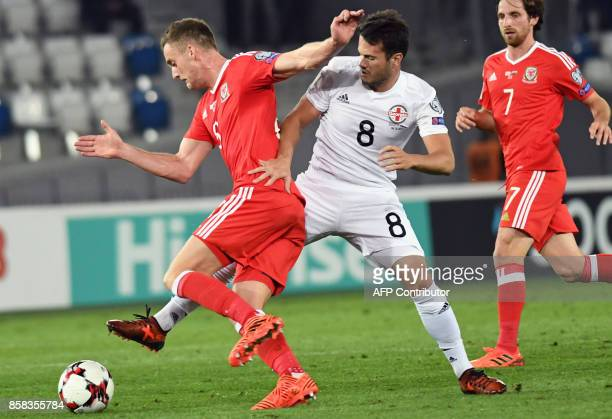 Wales' midfielder Andy King and Georgia's midfielder Valeri Kazaishvili vie for the ball during the FIFA World Cup 2018 qualification football match...