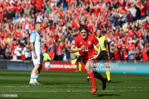 Wales' midfielder Daniel James celebrates after scoring their early opening goal during the UEFA Euro 2020 Group E qualification football match...