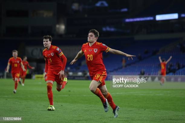 Wales' midfielder Daniel James celebrates scoring the opening goal during the FIFA World Cup Qatar 2022 qualification football match between Wales...