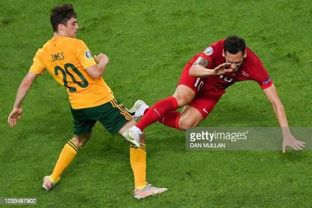 Wales' midfielder Daniel James challenges Turkey's midfielder Hakan Calhanoglu during the UEFA EURO 2020 Group A football match between Turkey and...