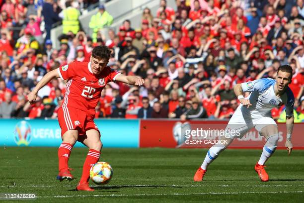 Wales' midfielder Daniel James shoots to score their early opening goal during the UEFA Euro 2020 Group E qualification football match between Wales...