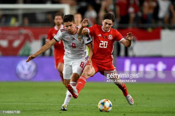 Wales' midfielder Daniel James vies with Hungary's midfielder Adam Nagy during the UEFA Euro 2020 qualifier Group E football match Hungary against...