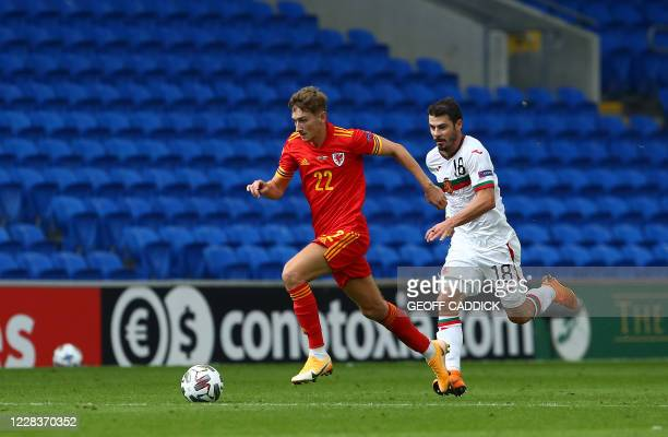 Wales' midfielder David Brooks pulls away from Bulgaria's midfielder Galin Ivanov during the UEFA Nations League football match between Wales and...