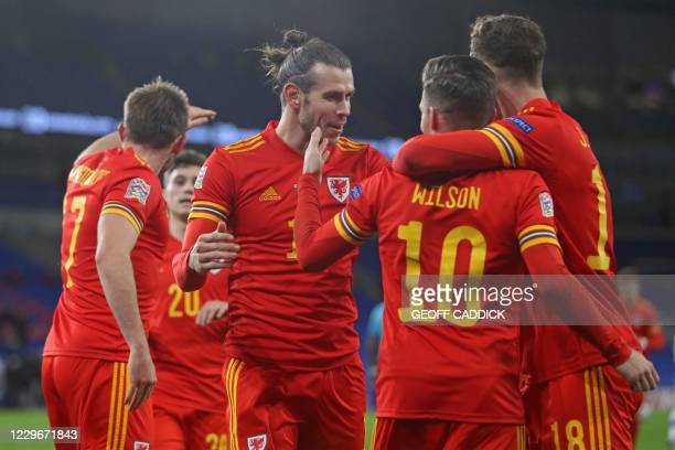 Wales' midfielder Harry Wilson celebrates with teammates after scoring the opening goal of the UEFA Nations League group B4 football match between...