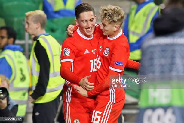 Wales' midfielder Harry Wilson celebrates with Wales' striker David Brooks after scoring the opening goal during the UEFA Nations League football...