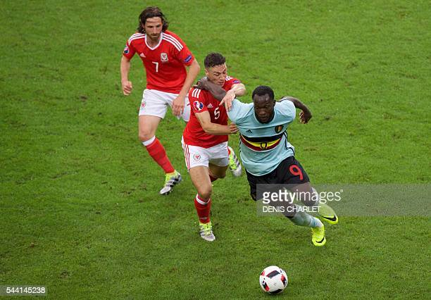 Wales' midfielder Joe Allen and Wales' defender James Chester challenge Belgium's forward Romelu Lukaku during the Euro 2016 quarterfinal football...