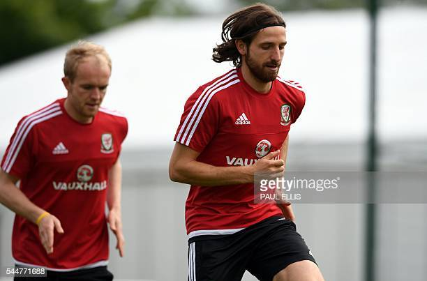 Wales' midfielder Joe Allen and Wales' midfielder Jonathan Williams take part in a training session in Dinard on July 04 2016 during the Euro 2016...