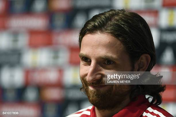 Wales' midfielder Joe Allen attends a press conference in Dinard Western France on June 18 during the Euro 2016 football tournament / AFP / DAMIEN...