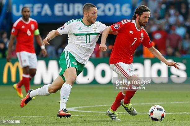 Wales' midfielder Joe Allen dribbles past Northern Ireland's forward Conor Washington during the Euro 2016 round of sixteen football match Wales vs...