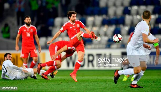 Wales' midfielder Joe Allen kicks the ball during the FIFA World Cup 2018 qualification football match between Georgia and Wales in Tbilisi on...